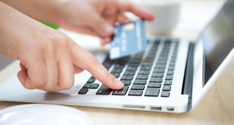 hand-with-a-credit-card-and-a-laptop_1232-619.png